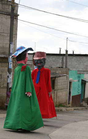 People dressed in stilt costumes entertain locals during this traditional Mayan celebration