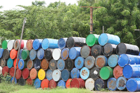 Stacks of colorful barrel once contained dangerous chemicals Stockfoto