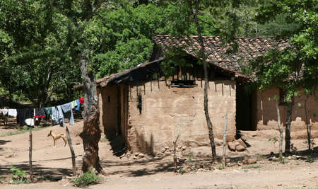 indigence: A poorly constructed mud house common throughout central america