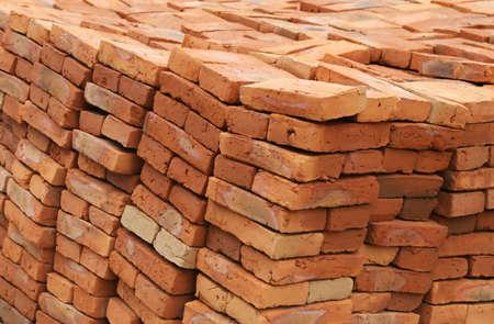 Handmade bricks ready for building