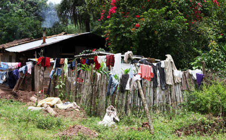 A rural home hangs its laundry to dry on the fence