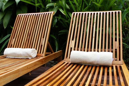 five star: Lounge chairs surround a pool at a five star resort