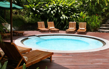 Lounge chairs surround a giant hot tub at this elegant five star resort Stock Photo - 2461577