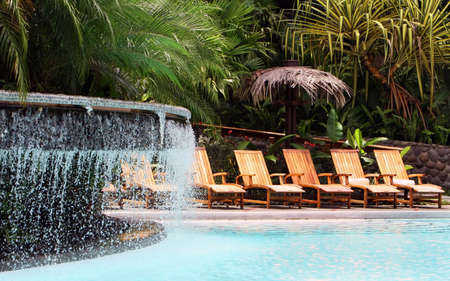Lounge chairs await guests at a swanky five star resort