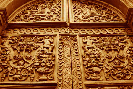 quito: Detail of giant carved wooden doors leading into a cathedral in Quito, Ecuador Stock Photo