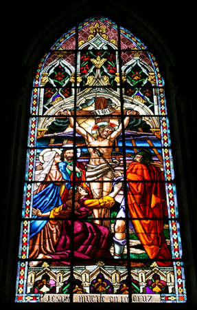 catholism: Jesus Died On the Cross Stained Glass Stock Photo