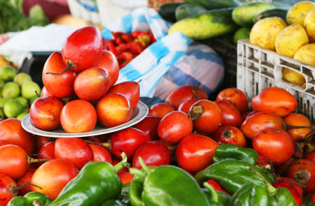 Fresh fruit and vegetables piled high at the local market Stock Photo