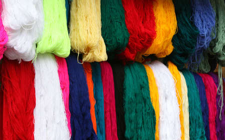 Colorful yarn for sale in the market photo