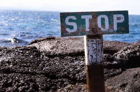 warns: This stop sign warns visitors to stay away from the edge of the rocky bluff Stock Photo