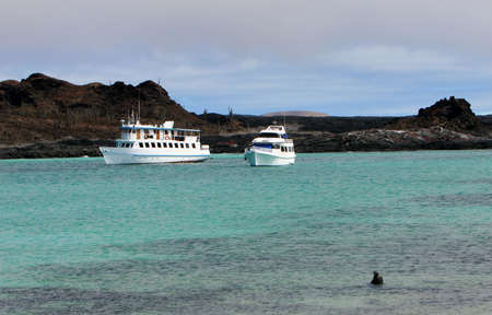 Two Yachts are anchored off shore in the Galapagos Islands Stock Photo - 3435596