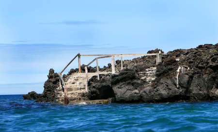 rickety: Old steps lead down into the ocean on the Galapagos Islands