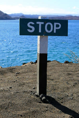 warns: This stop sign warns visitors against walking off the cliff Stock Photo