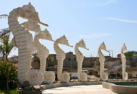 impoverished: A Seahorse fountain array idles in front on an impoverished Peruvian town