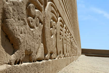 friezes: Ancient frieze carvings at the site of Chan Chan in Peru Stock Photo