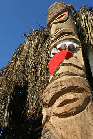 A totem pole carved out of wood in Peru photo
