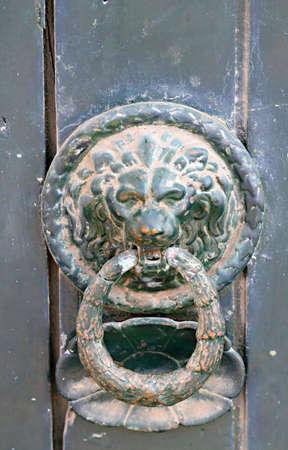 A lion head on a old doorknocker