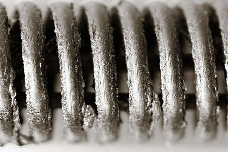 extreme closeup of a metal print with grease on it Stock Photo