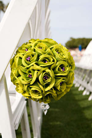 Wedding seats with green boquet of flowers