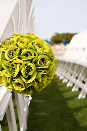 reserved seat: Wedding boquet used to reserve seats at an outdoor ceremony