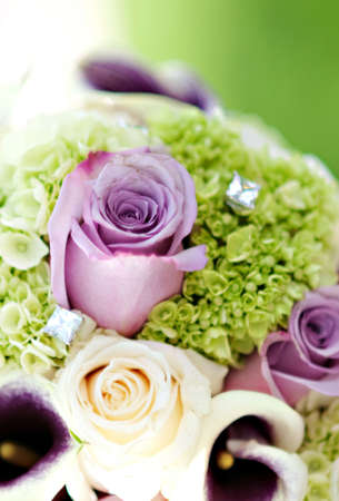 A beautiful wedding boquet of roses and diamonds
