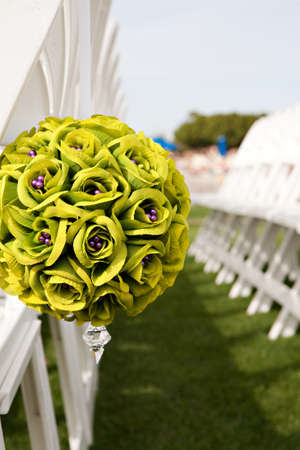 Wedding boquet used to reserve seats at an outdoor ceremony