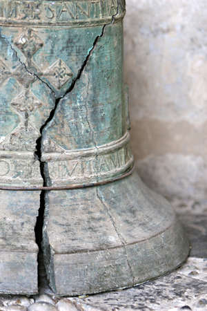An Old Cracked Bell with spanish writing