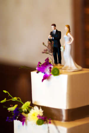 The cake toppers on a beautiful wedding cake