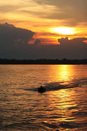 boater: A small boast cruises down the Amazon River in Peru