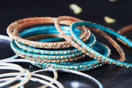 Close up shot of many indian style bangle bracelets photo