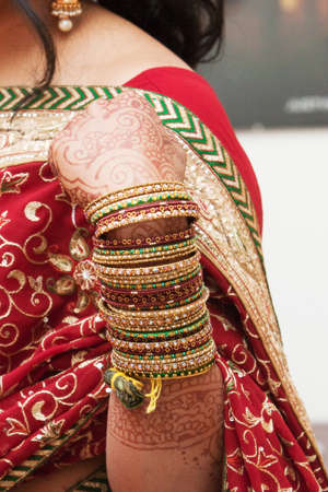 Bangles on the arm of a young hindu bride