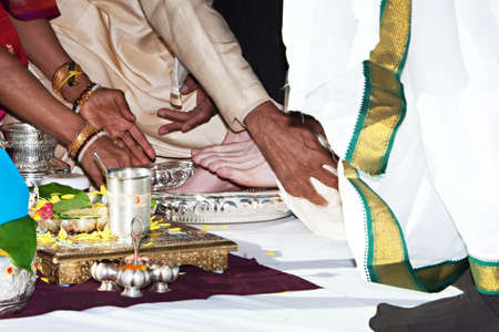 traditinal: A groom has his feet washed during a traditinal Hindu Indian wedding ceremony