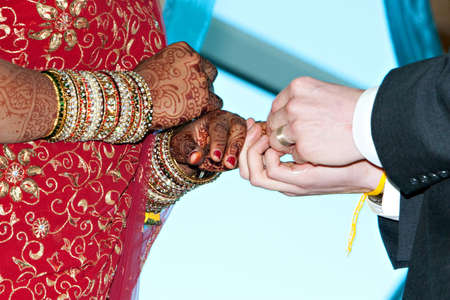 A bride and groom exchange rings during a wedding ceremony