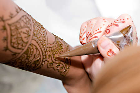 A Hindu Bride has Henna applied to her hands
