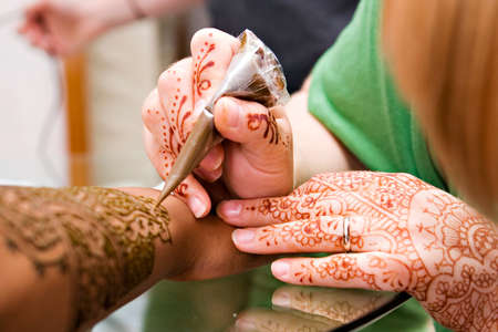 applied: A Hindu Bride has Henna applied to her hands Editorial