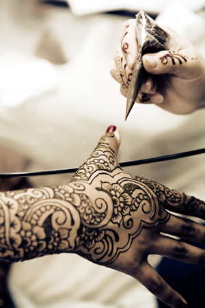 indian art: A Hindu Bride has Henna applied to her hands Editorial