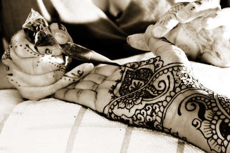 Henna is applied to the hands of a Hindu Bride Stock Photo
