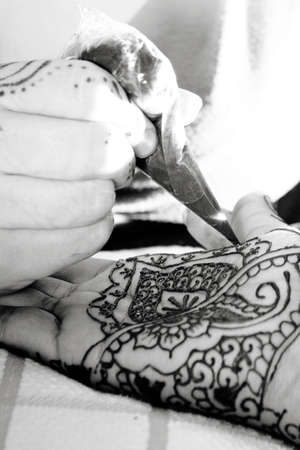 Henna is applied to the hands of a Hindu Bride photo