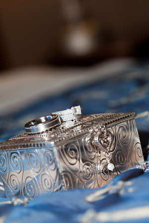 silver jewelry: Beautiful wedding bands on top of a silver jewelry box