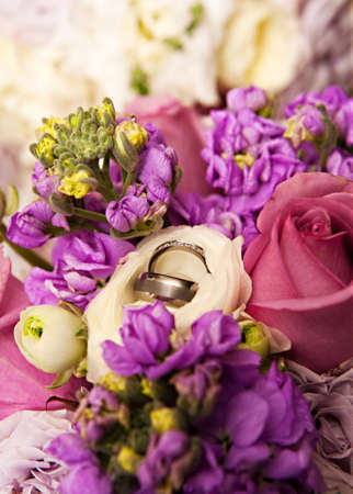 Beautiful wedding rings in a boquet of flowers. photo