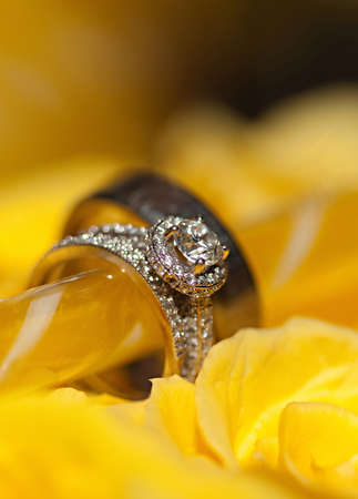 A close-up shot of a beautiful wedding ring with yellow background