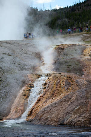 boiling: A river of boiling hot water runs from a thermal pool in Yellowstone Nation Park; Wyoming