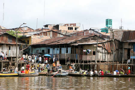 rise above: Houses on stilts rise above the polluted water in Belen, Iquitos, Peru. Thousands of people live here in extreme poverty without clean water or sanitation.