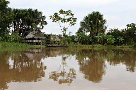 An indigenous house in the Amazon river basin near Iquitos, Peru photo