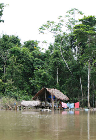An indigenous house in the Amazon river basin near Iquitos, Peru Stock Photo