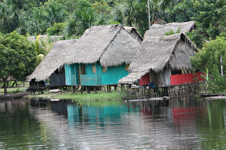 peru amazon: An indigenous house in the Amazon river basin near Iquitos, Peru Stock Photo