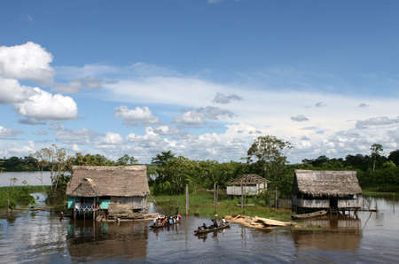 amazon river: An indigenous house in the Amazon river basin near Iquitos, Peru Stock Photo