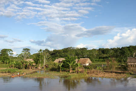 An indigenous village in the Amazon river basin near Iquitos, Peru Stock Photo