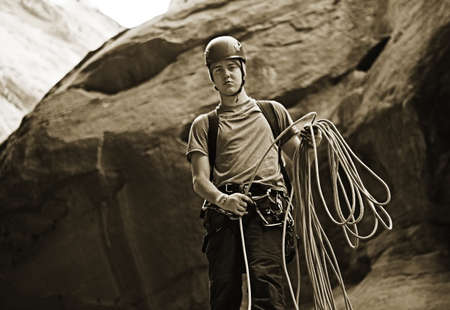Coiling a static rope during the technical descent of a slot canyon in the southwest, United States