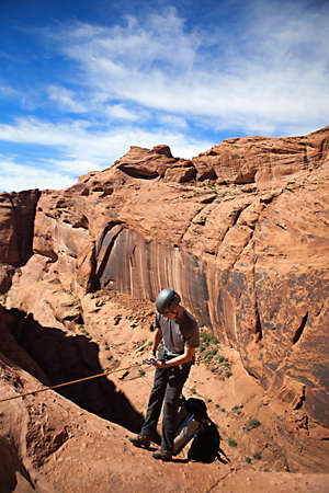 abseil: A young man explores a technical slot canyon in northern Arizona, USA Stock Photo