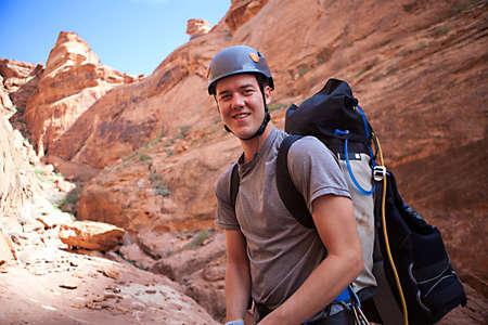 slot canyon: A young man explores a technical slot canyon in northern Arizona, USA Stock Photo